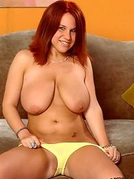 Sexy red head licks her big tits
