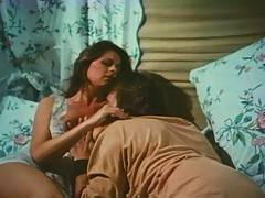 Two girls share a hard dick in this retro threesome footage
