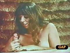 A sweet looking brunette pornbabe giving head in retro vids
