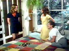 Two brunette seventies ladies fucked hard by John Holmes