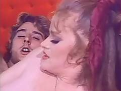 Busty retro redhead with red pussy sucks on cock for facial