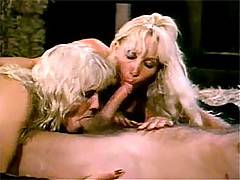 Two naughty seventies blondes enjoying a cock in the barn
