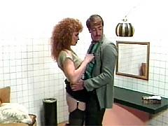 Big haired classic MILF sucks a guys hard cock in a bathroom